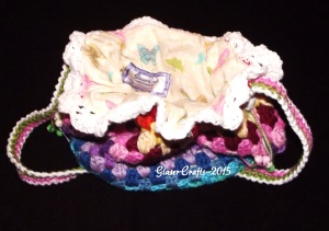 crochet coloured pouch- lined with butterflies, and pocket featured